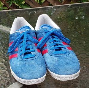 Light blue Adidas Gazelles